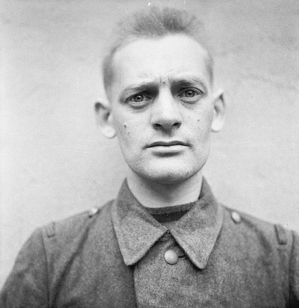 582px-The_Liberation_of_Bergen-belsen_Concentration_Camp_1945-_Portraits_of_Belsen_Guards_at_Celle_Awaiting_Trial_August_1945_BU9740