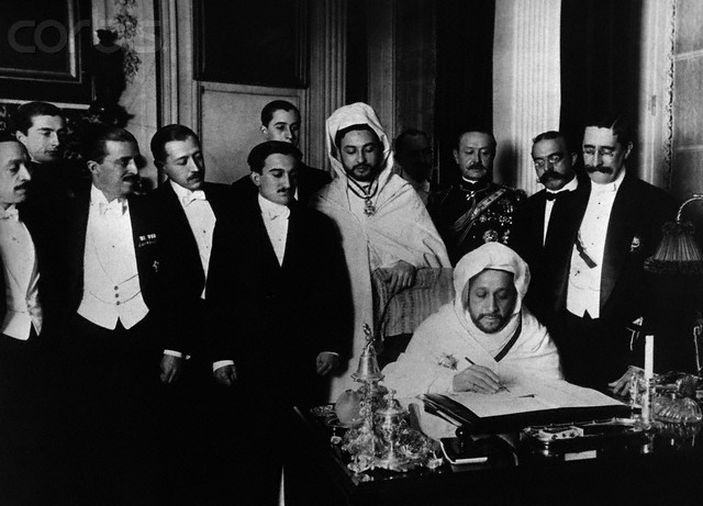 07 Apr 1906, Algeciras, Spain --- El-Hadj el-Mokri, Ambassador to Spain, signs the treaty at the Algeciras Conference allowing France to patrol the border with Algeria and Spain to police Morocco. --- Image by © Hulton-Deutsch Collection/CORBIS
