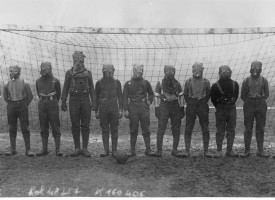 World_War_I,_British_soccer_team_with_gas_masks,_1916