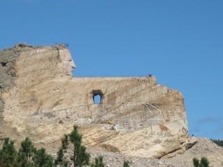 Mt. Rushmore og hin ókláraða Crazy Horse-stytta sem reist var því til höfuðs